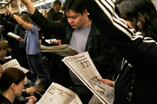 NYC_subway_riders_with_their_newspapers.jpg